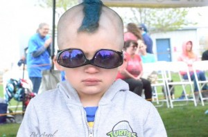 A little boy with blue hair
